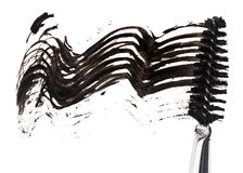 Slag van zwarte mascara met instrumentenborstel Stock Foto