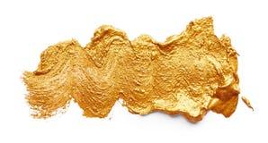 Slagen van gouden verf stock foto