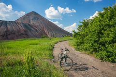 Slagheap and bike of ukrainian steppe Royalty Free Stock Photography