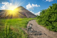 Slagheap and bike of ukrainian steppe Royalty Free Stock Photos