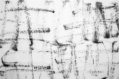 Slaglängder av svart färgpulver på en vit bakgrund Royaltyfri Fotografi