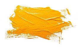 Slaglängder för gul ockra av den isolerade målarfärgborsten royaltyfri bild