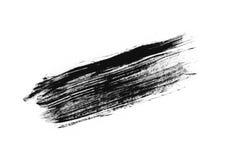 Slaglängd (prövkopia) av svart mascara som isoleras på den vita makroen Royaltyfri Bild