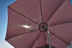 Slags solskydd för strandparaply Arkivbilder