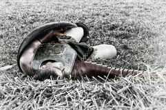 Slain gladiator. A slain gladiator, lying on the battlefield, waiting for Charon to take him to the underworld. Historical reenactment at the Transylvania stock images