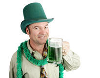 Slainte!. Man celebrating his Irish heritage on St. Patrick's Day, making a toast with green beer Royalty Free Stock Photos