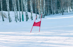 Slalom flag standing in the snow on the ski slopes Royalty Free Stock Image