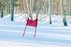 Slalom flag standing in the snow on the ski slopes.  Stock Photography