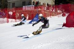 Slalom gigante paralelo do Snowboard foto de stock