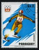 Slalom skier at Winter Olympics in Innsbruck. RUSSIA KALININGRAD, 19 APRIL 2017: stamp printed by Paraguay, shows Slalom skier at Winter Olympics in Innsbruck Stock Image