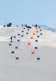 Slalom slope with colorful orange and blue gates Royalty Free Stock Images