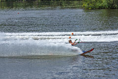 Slalom, water skis, editorial. Novopolotsk, Belarus - June 10, 2017: the annual international tournament on water skiing, held on lake Lyuhovo. Athlete water stock image