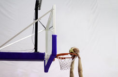 Slam dunk. At the hoop in a basketball game royalty free stock images