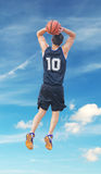 Slam dunk with clouds Royalty Free Stock Photo