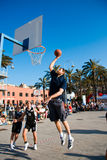 Slam dunk by Jack Galanda. Basket demonstration during the Festival of Sport on 16th May 2009 at the Porto Antico of Genoa. In this shot a slam dunk by Giacomo royalty free stock photos