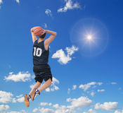 Slam dunk in the sky Stock Image