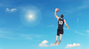 Slam dunk in the sky Stock Images
