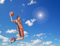 Slam dunk in the sun Royalty Free Stock Image
