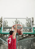 Slam dunk by young man Royalty Free Stock Images