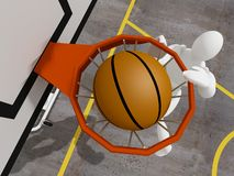 Slam dunking basketball Stock Image
