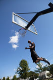 Slam Dunking a Basketball Stock Image