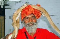 Slangenbezweerder stock foto