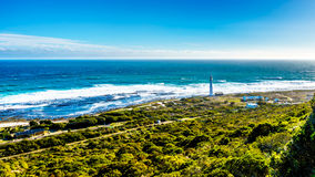 Slangkop Lighthouse on the Atlantic coast along the road to Chapman`s Peak in the Cape Peninsula Stock Photography