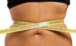 slank meisje dat haar taille meet Stock Fotografie