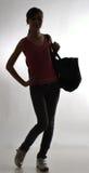 Slank meisje met een zak Royalty-vrije Stock Afbeeldingen