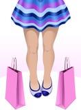 Slanka ben för kvinnlig med shoppingpåsar Royaltyfri Illustrationer