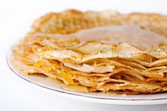 Slanka pannkakor vikt glidbana med honung Royaltyfria Bilder