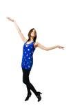 Slanke jonge vrouw in blauwe kleding op wit Stock Foto's
