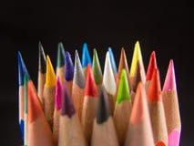 Slanke kleurpotlooduiteinden op zwarte Stock Foto's