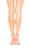 Slanke mooie vrouwelijke benen achtermening Stock Foto