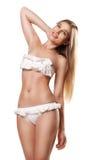 Slanke sexy gelukkige geïsoleerde vrouw in swimwear Stock Foto's