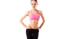 Slanke taille van jonge sportieve vrouw, detail van perfect geschikt vrouwelijk geïsoleerd lichaam Royalty-vrije Stock Afbeelding