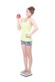 Slanke vrouw met schalen Stock Foto