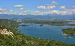 Slansko Jezero. Lake in Montenegro. Montenegro's second city, Niksic, can be seen in the distance Stock Photo