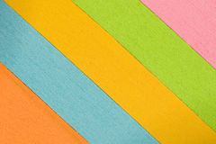 Slanted Multi-colored Stacks of Paper Background Stock Image