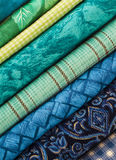 Slanted Stack of Blue and Green Fabrics Stock Photo