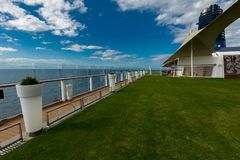 Slanted View of the Green Lawn and White Pots Aboard Celebrity Eclipse Cruise royalty free stock photography