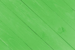 Slanted wooden planks in green with copy space Stock Images