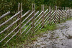Slanting fence made of poles in rural areas. Slanting fence made of poles in rural Stock Image