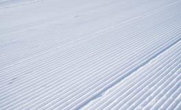 Slanting line of snowcat on white snow. Slanting line of snowcat on white and fluffy snow Stock Photography