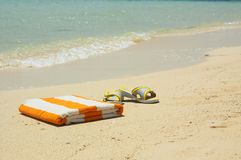 Slantsy of beach and towel at a sea. Royalty Free Stock Image
