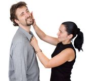 Slap. Woman gives her man slaps isolated Stock Photography