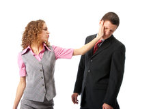 Slap. Girl slapping in the face to man. Isolated over white Royalty Free Stock Image
