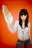 Slap!. A trendy Caucasian teen holds her hand out as if preparing to slap someone Royalty Free Stock Photo