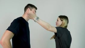 Slap in the face. Relationship difficulties young woman having an argument with her boyfriend, slow motion. Slap in the face. Relationship difficulties young stock video footage
