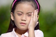 Slaperig Filipina Girl stock afbeelding